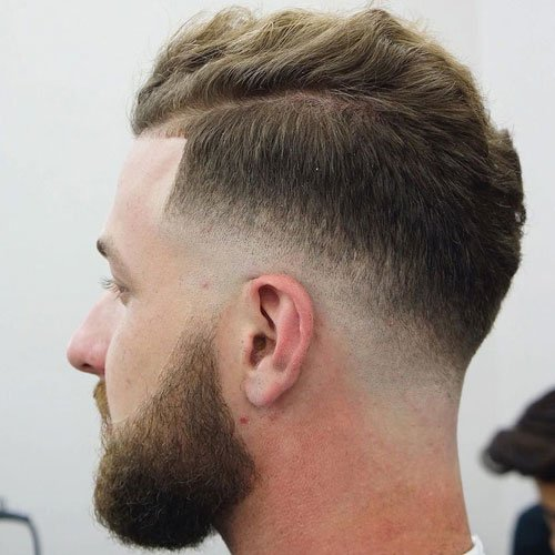Low Skin Drop Fade + Wavy Hair on Top + Beard
