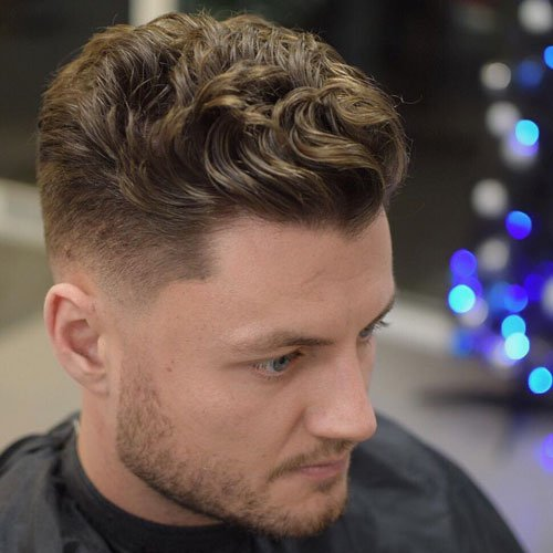 Low Skin Fade + Short Wavy Slick Back