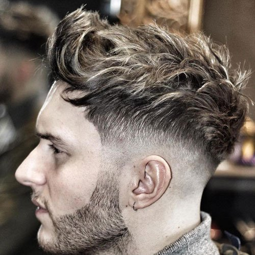 Low Skin Fade with Long Wavy Hair