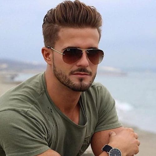 Attractive Hairstyles For Men - Thick Brushed Back Hair with Taper Fade