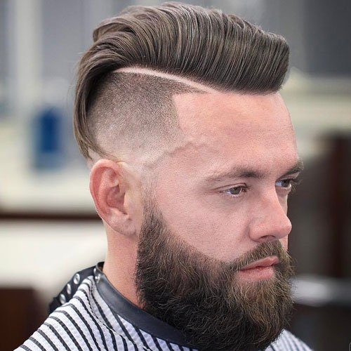 Medium length Haircuts + Hard Part Comb Over + Cool Beard Design