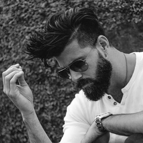 Medium Length Textured Hair with Short Sides and Beard