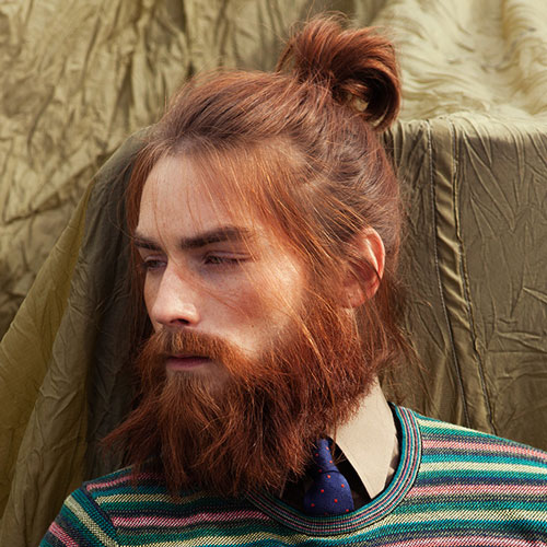 Man Bun Hairstyle With Thick Beard