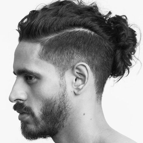 Man Bun Hairstyle with Undercut Fade