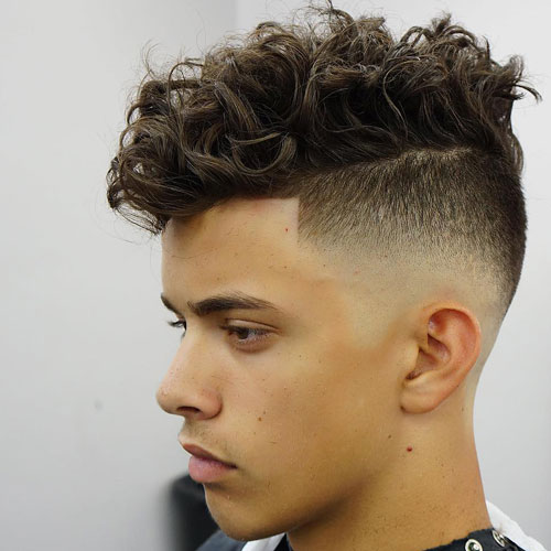High Skin Fade + Messy Medium-Length Curly Hair