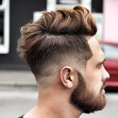 Low Skin Fade with Part and Messy Wavy Top