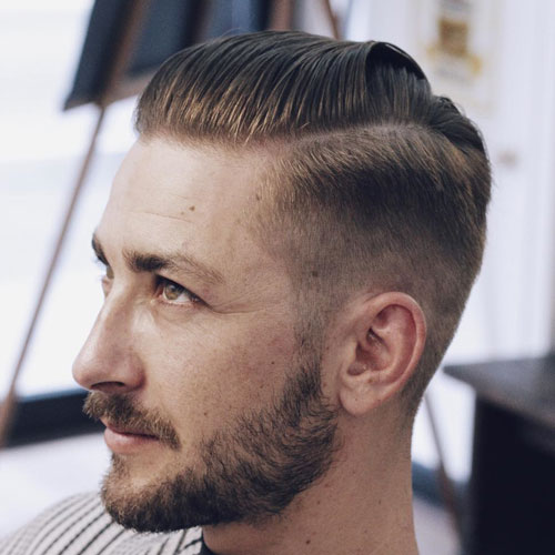 Angular Slicked Back Hair with High Fade and Part