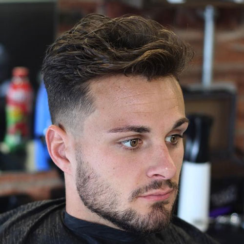 Messy Brushed Back Hair with Low Fade and Beard