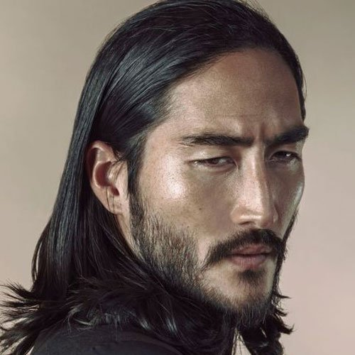 Asian Young Man With Long Hair Posing The Era A Serious Look