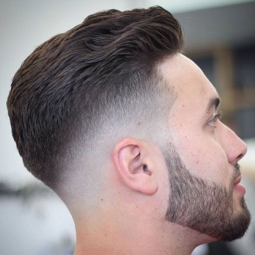 High Bald Fade with Line Up and Wavy Brush Back