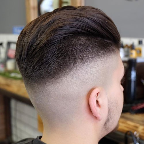 High Skin Razor Fade with Brushed Up Hair