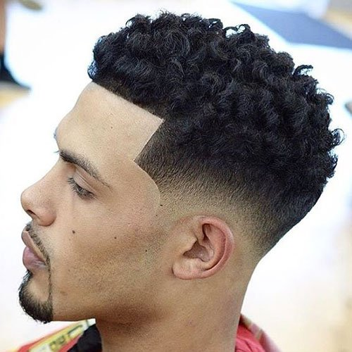 Low Bald Fade with Short Curls