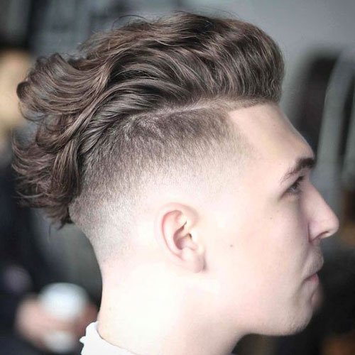 Undercut Fade with Wavy Slicked Back Hair