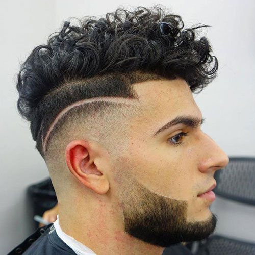 High Skin Fade With Textured Curly Top And Beard