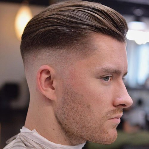 Slicked Back Hair with Mid Skin Fade