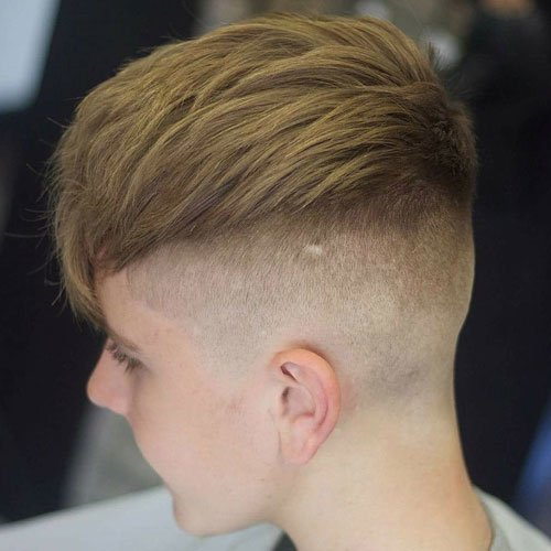High Skin Fade + Long Textured Fringe