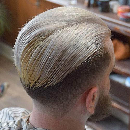 Blonde Slicked Back Hair + Fade