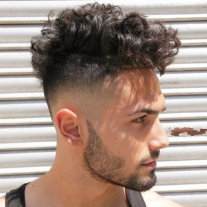 Messy Curly Top with Bald Fade on the Sides