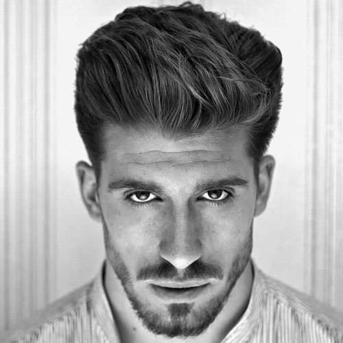 Cool Medium-Length Textured Hairstyles For Men - Thick Brushed Back Hair + Low Taper Fade