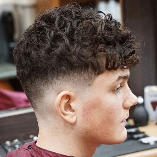 Curly Hair Taper Fade Haircut For Teenage Boys