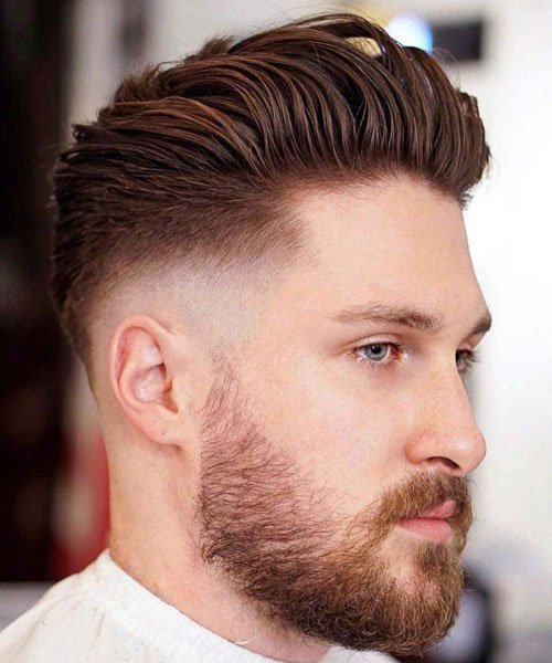 Slick Back Hairstyle with Mid Skin Fade Haircut